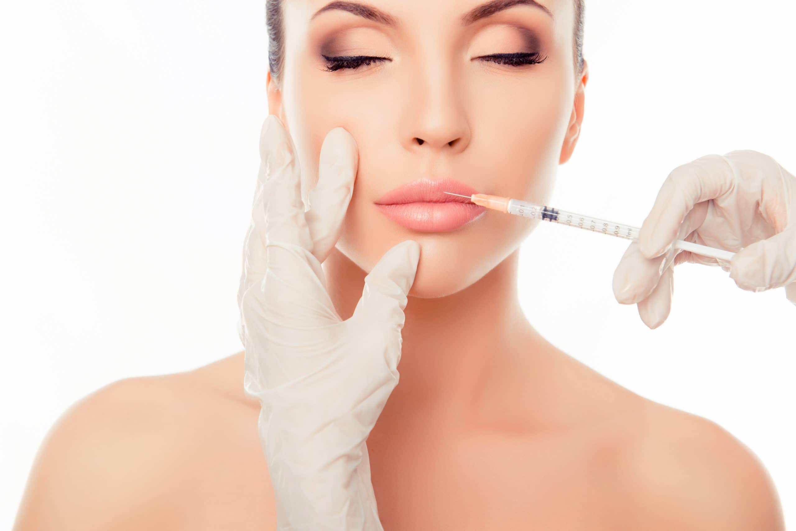 plastic,surgery.,young,woman,geting,cosmetic,injection,in,lips